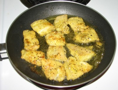 Fish being shallow fried for fish molee